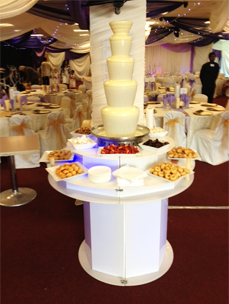 White Chocolate Fountains on display with Fruit and Sweets